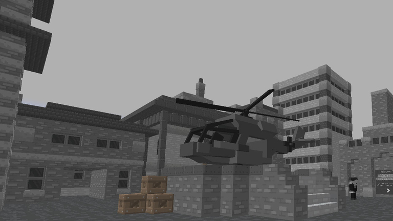 A black and white view of a helicopter, having landed in a small city